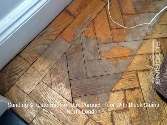 Sanding & restoration of oak parquet floor with black stains in North London