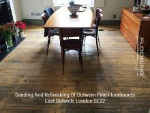 Sanding and refinishing of outworn pine floorboards in Dulwich