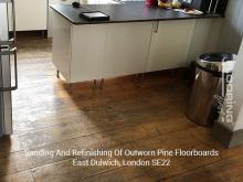 Sanding and refinishing of outworn pine floorboards in Dulwich 1