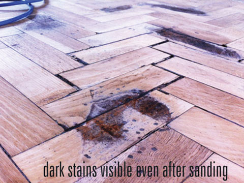 Dark stains on wood floors