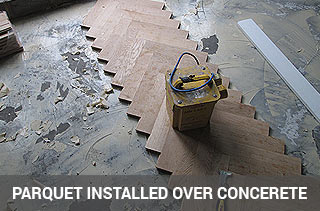 Parquet floor fitting over concrete subfloor