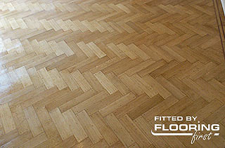Parquet flooring fitted in herringbone pattern
