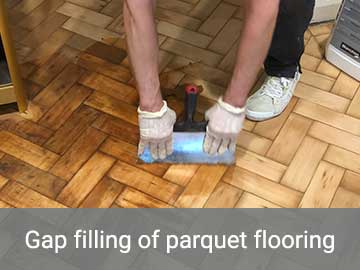 Gap filling of parquet flooring