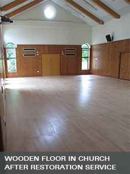 the hardwood flooring in a church after sanding and sealing