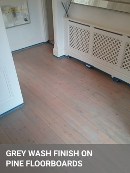 grey wash finish on pine floorboards