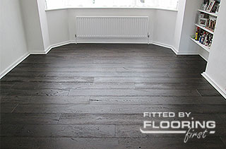 Dark hardwood flooring installed by flooringfirst!