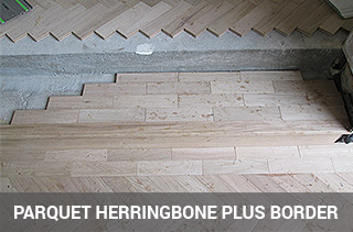 parquet floor fitting in herringbone pattern and border