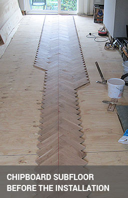 Subfloor preparation with chipboard before fitting the parquet