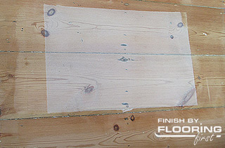 Sample of whitewash finish applied on wooden flooring